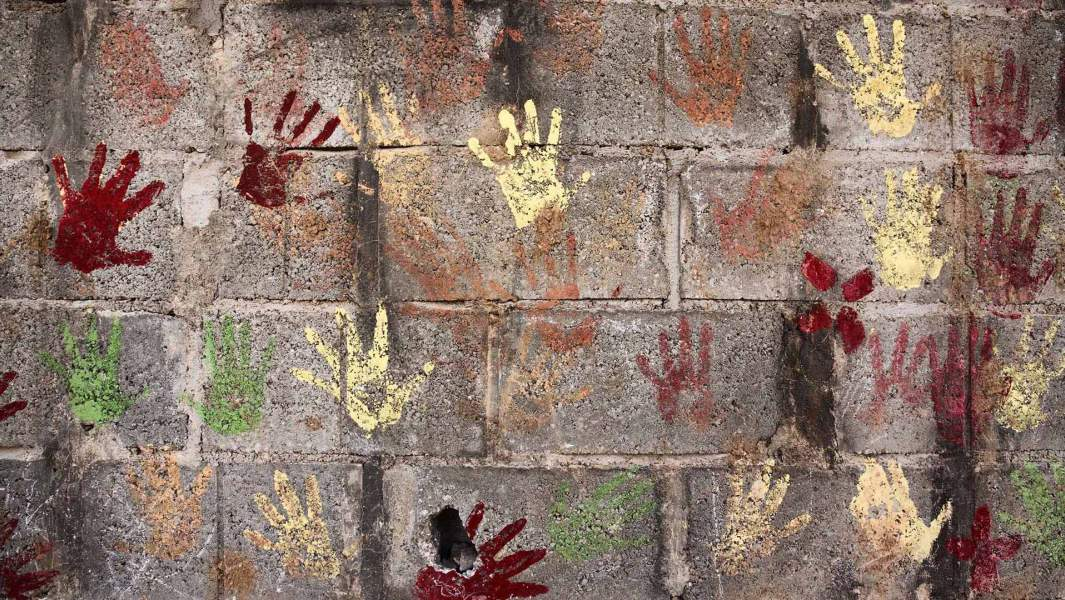 Imprints of children's hands on the wall in one of the camps for Syrian refugees in Jordan, 10 kilometers from the Syrian border
