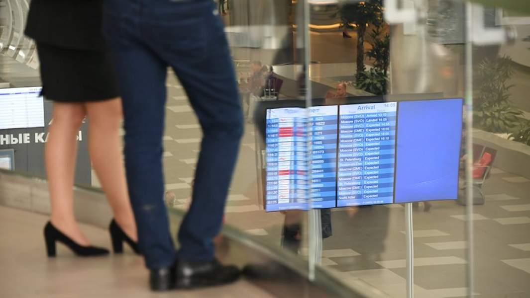 Пассажиры у стойки регистрации