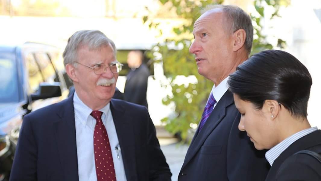 Секретарь Совета безопасности РФ Николай Патрушев и советник президента США по вопросам национальной безопасности Джон Болтон во время встречи в Москве. 22 октября 2018 года