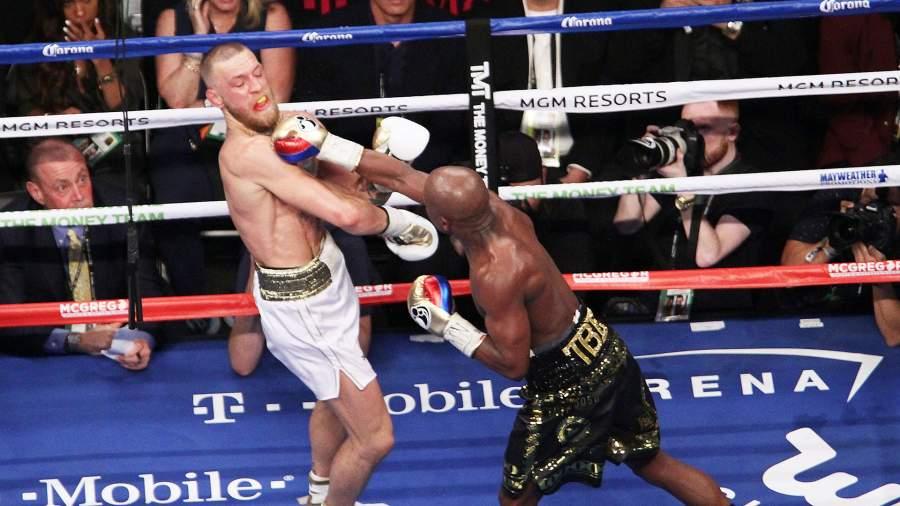 Американский боксёр-профессионал Флойд Мейвезер противчемпиона UFC Конора Макгрегора